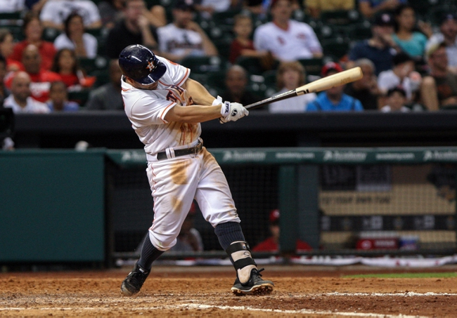 Sep 16, 2013; Houston, TX, USA; Houston Astros second baseman Jose Altuve (27) gets a hit during the eighth inning against the Cincinnati Reds at Minute Maid Park. Mandatory Credit: Troy Taormina-USA TODAY Sports