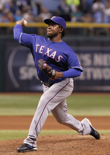 Sep 16, 2013; St. Petersburg, FL, USA; Texas Rangers starting pitcher Neftali Feliz (30) throws a pitch during the sixth inning against the Tampa Bay Rays at Tropicana Field. Tampa Bay Rays defeated the Texas Rangers 6-2. Mandatory Credit: Kim Klement-USA TODAY Sports