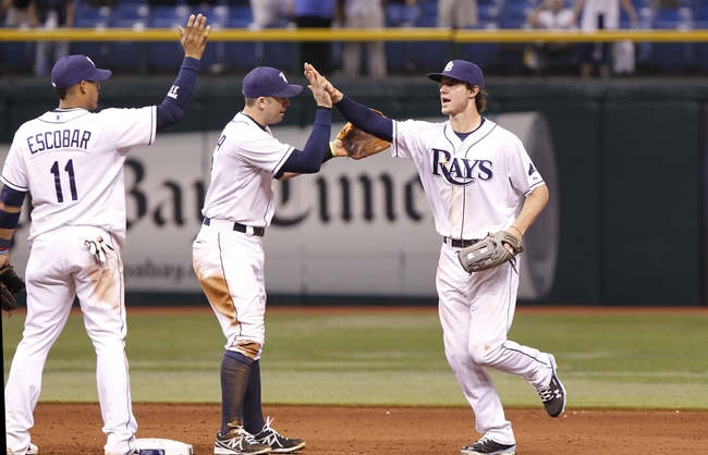 Sep 16, 2013; St. Petersburg, FL, USA; Tampa Bay Rays right fielder Wil Myers (9),  third baseman Evan Longoria (3) and shortstop Yunel Escobar (11) congratulate each other after they beat the Texas Rangers at Tropicana Field. Tampa Bay Rays defeated the Texas Rangers 6-2. Mandatory Credit: Kim Klement-USA TODAY Sports