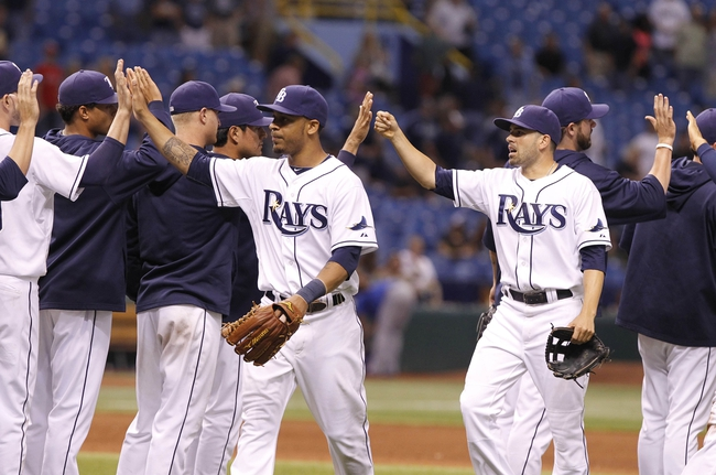 Sep 16, 2013; St. Petersburg, FL, USA; Tampa Bay Rays center fielder Desmond Jennings (8) and left fielder David DeJesus (7) high five teammates after they beat the Texas Rangers at Tropicana Field. Tampa Bay Rays defeated the Texas Rangers 6-2. Mandatory Credit: Kim Klement-USA TODAY Sports