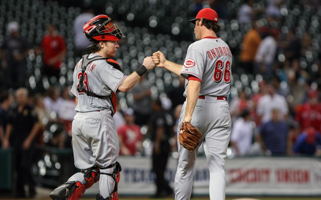 Sep 16, 2013; Houston, TX, USA; Cincinnati Reds catcher Ryan Hanigan (29) and relief pitcher Logan Ondrusek (66) celebrate after defeating the Houston Astros 6-1at Minute Maid Park. Mandatory Credit: Troy Taormina-USA TODAY Sports