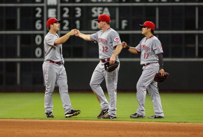Sep 16, 2013; Houston, TX, Cincinnati Reds player Jay Bruce (32) celebrates with teammates after defeating the Houston Astros 6-1at Minute Maid Park. Mandatory Credit: Troy Taormina-USA TODAY Sports