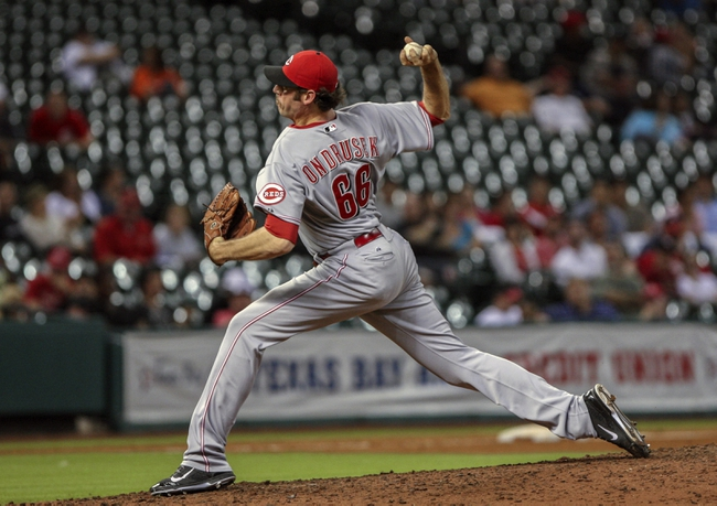 Sep 16, 2013; Houston, TX, USA; Cincinnati Reds relief pitcher Logan Ondrusek (66) pitches during the ninth inning against the Houston Astros at Minute Maid Park. Mandatory Credit: Troy Taormina-USA TODAY Sports