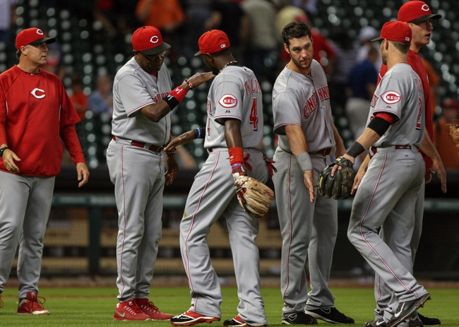Sep 16, 2013; Houston, TX, USA; Cincinnati Reds manager Dusty Baker (12) congratulates his team including second baseman Brandon Phillips (4) after defeating the Houston Astros 6-1at Minute Maid Park. Mandatory Credit: Troy Taormina-USA TODAY Sports