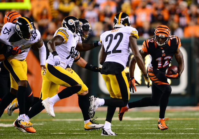 Sep 16, 2013; Cincinnati, OH, USA; Cincinnati Bengals wide receiver Mohamed Sanu (12) looks to get around Pittsburgh Steelers cornerback William Gay (22) during the fourth quarter at Paul Brown Stadium. Mandatory Credit: Andrew Weber-USA TODAY Sports