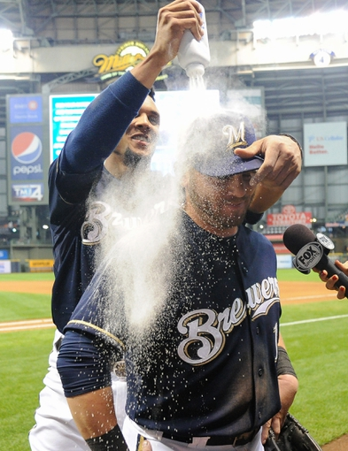 Sep 16, 2013; Milwaukee, WI, USA;  Milwaukee Brewers left fielder Caleb Gindl is doused with powder by center fielder Carlos Gomez after the Brewers beat the Chicago Cubs 6-1 at Miller Park. Gindl had 3 hits, scored 3 runs and had 3 RBIs.  Mandatory Credit: Benny Sieu-USA TODAY Sports