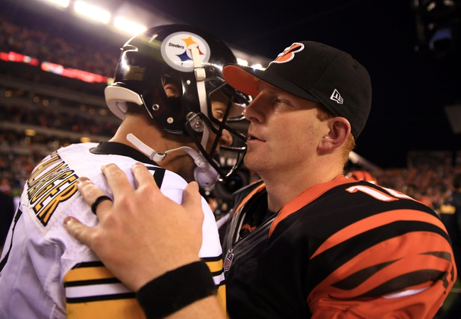 Sep 16, 2013; Cincinnati, OH, USA; Pittsburgh Steelers quarterback Ben Roethlisberger (7) talks with Cincinnati Bengals quarterback Andy Dalton (14) after the Cincinnati Bengals defeated the Pittsburgh Steelers 20-10 at Paul Brown Stadium. Mandatory Credit: Andrew Weber-USA TODAY Sports