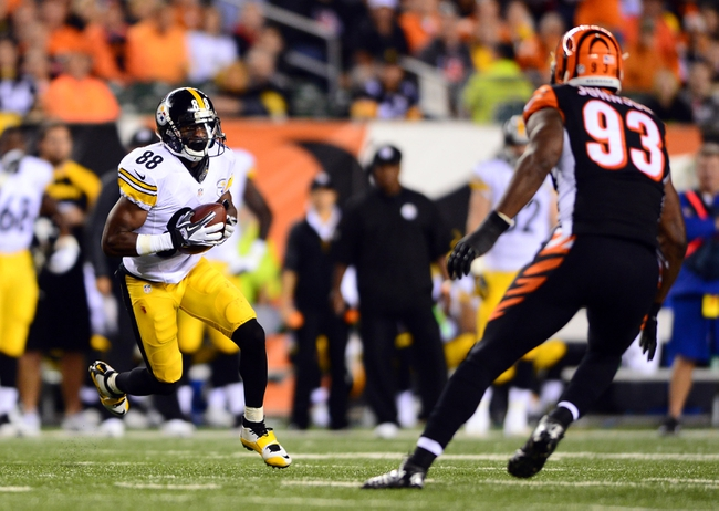 Sep 16, 2013; Cincinnati, OH, USA; Pittsburgh Steelers wide receiver Emmanuel Sanders (88) looks to get around Cincinnati Bengals defensive end Michael Johnson (93) during the fourth quarter at Paul Brown Stadium. Mandatory Credit: Andrew Weber-USA TODAY Sports