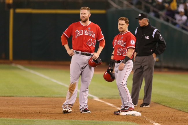 Sep 16, 2013; Oakland, CA, USA; Los Angeles Angels first baseman Mark Trumbo (44) and right fielder Kole Calhoun (56) stand while a new Oakland Athletics pitcher warms up during the fifth inning at O.co Coliseum. Mandatory Credit: Kelley L Cox-USA TODAY Sports