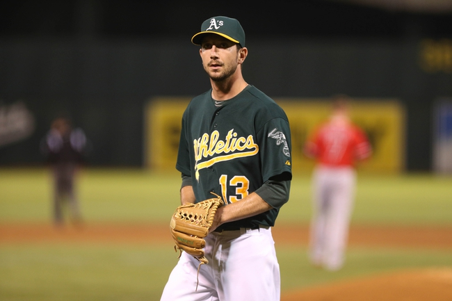 Sep 16, 2013; Oakland, CA, USA; Oakland Athletics relief pitcher Jerry Blevins (13) returns to the dugout against the Los Angeles Angels during the fifth inning at O.co Coliseum. Mandatory Credit: Kelley L Cox-USA TODAY Sports