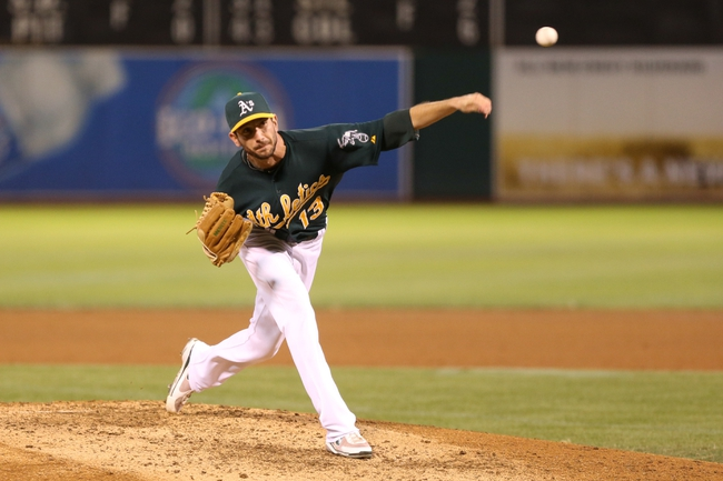 Sep 16, 2013; Oakland, CA, USA; Oakland Athletics relief pitcher Jerry Blevins (13) pitches the ball against the Los Angeles Angels during the fifth inning at O.co Coliseum. Mandatory Credit: Kelley L Cox-USA TODAY Sports