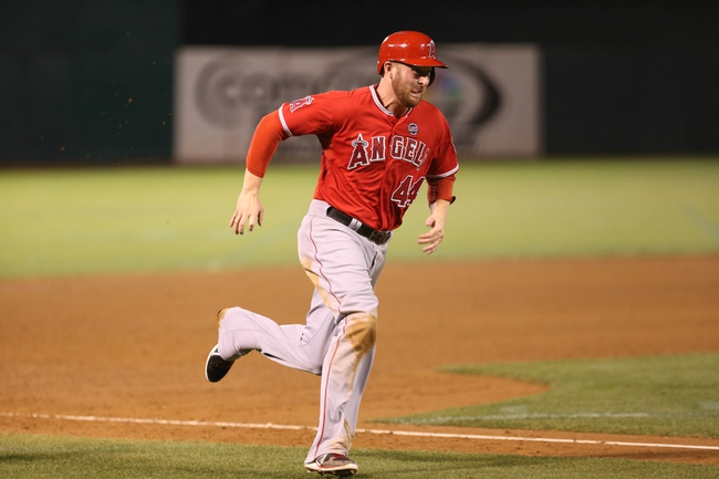 Sep 16, 2013; Oakland, CA, USA; Los Angeles Angels first baseman Mark Trumbo (44) runs home against the Oakland Athletics during the fifth inning at O.co Coliseum. Mandatory Credit: Kelley L Cox-USA TODAY Sports