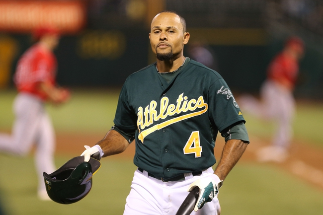 Sep 16, 2013; Oakland, CA, USA; Oakland Athletics center fielder Coco Crisp (4) removes his helmet after striking out against the Los Angeles Angels during the fifth inning at O.co Coliseum. Mandatory Credit: Kelley L Cox-USA TODAY Sports