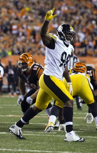 Sep 16, 2013; Cincinnati, OH, USA; Pittsburgh Steelers linebacker Vince Williams (98) calls out a defensive shift against the Cincinnati Bengals at Paul Brown Stadium. Cincinnati won the game 20-10. Mandatory Credit: Greg Bartram-USA TODAY Sports