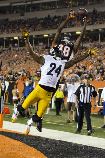 Sep 16, 2013; Cincinnati, OH, USA; Cincinnati Bengals wide receiver A.J. Green (18) tries to make a touchdown catch as Pittsburgh Steelers cornerback Ike Taylor (24) defends at Paul Brown Stadium. Cincinnati won the game 20-10. Mandatory Credit: Greg Bartram-USA TODAY Sports