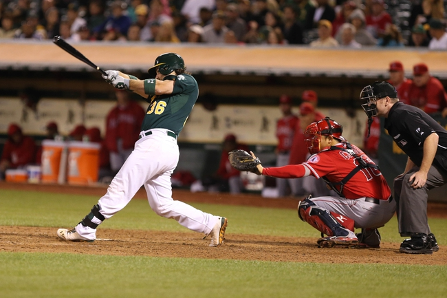 Sep 16, 2013; Oakland, CA, USA; Oakland Athletics catcher Derek Norris (36) hits an RBI single against the Los Angeles Angels during the sixth inning at O.co Coliseum. Mandatory Credit: Kelley L Cox-USA TODAY Sports