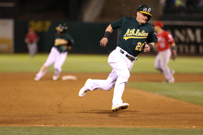 Sep 16, 2013; Oakland, CA, USA; Oakland Athletics third baseman Josh Donaldson (20) rounds third for a run followed by designated hitter Yoenis Cespedes (52) reaching third base on an RBI single by catcher Derek Norris (not pictured) against the Los Angeles Angels during the sixth inning at O.co Coliseum. Mandatory Credit: Kelley L Cox-USA TODAY Sports