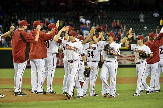 Sep 16, 2013; Phoenix, AZ, USA; Members of the Arizona Diamondbacks celebrate after defeating Los Angeles Dodgers 2-1 at Chase Field. Mandatory Credit: Matt Kartozian-USA TODAY Sports