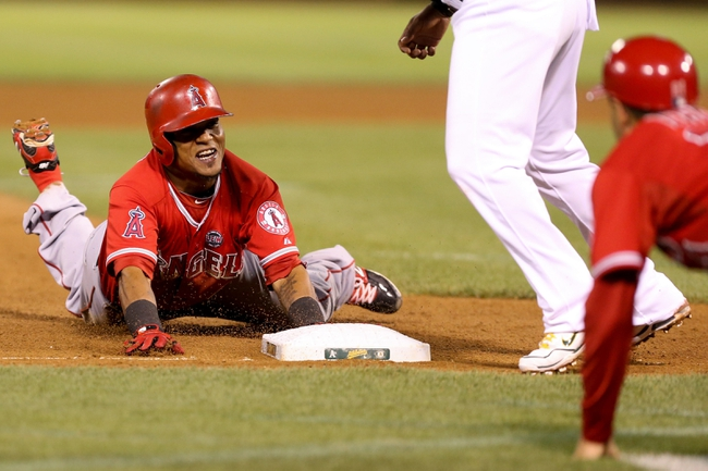 Sep 16, 2013; Oakland, CA, USA; Los Angeles Angels shortstop Erick Aybar (2) slides safely to third base for a triple against the Oakland Athletics during the seventh inning at O.co Coliseum. Mandatory Credit: Kelley L Cox-USA TODAY Sports