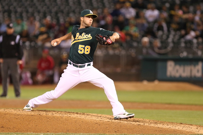 Sep 16, 2013; Oakland, CA, USA; Oakland Athletics relief pitcher Evan Scribner (58) pitches the ball against the Los Angeles Angels during the seventh inning at O.co Coliseum. Mandatory Credit: Kelley L Cox-USA TODAY Sports