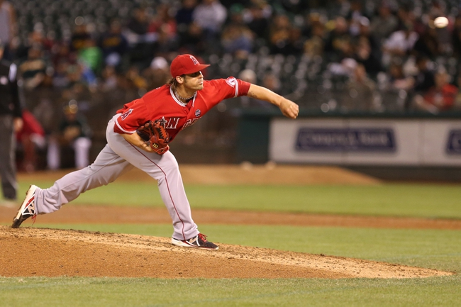Sep 16, 2013; Oakland, CA, USA; Los Angeles Angels starting pitcher C.J. Wilson (33) pitches the ball against the Oakland Athletics during the seventh inning at O.co Coliseum. Mandatory Credit: Kelley L Cox-USA TODAY Sports