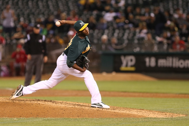 Sep 16, 2013; Oakland, CA, USA; Oakland Athletics relief pitcher Pedro Figueroa (65) pitches the ball against the Los Angeles Angels during the eighth inning at O.co Coliseum. Mandatory Credit: Kelley L Cox-USA TODAY Sports
