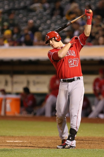 Sep 16, 2013; Oakland, CA, USA; Los Angeles Angels center fielder Mike Trout (27) swings between pitches against the Oakland Athletics during the eighth inning at O.co Coliseum. Mandatory Credit: Kelley L Cox-USA TODAY Sports