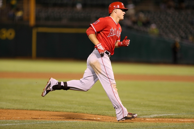 Sep 16, 2013; Oakland, CA, USA; Los Angeles Angels center fielder Mike Trout (27) rounds the bases on a two run home run against the Oakland Athletics during the eighth inning at O.co Coliseum. Mandatory Credit: Kelley L Cox-USA TODAY Sports