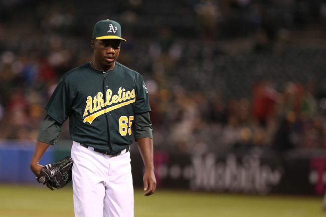 Sep 16, 2013; Oakland, CA, USA; Oakland Athletics relief pitcher Pedro Figueroa (65) returns to the dugout against the Los Angeles Angels during the eighth inning at O.co Coliseum. Mandatory Credit: Kelley L Cox-USA TODAY Sports