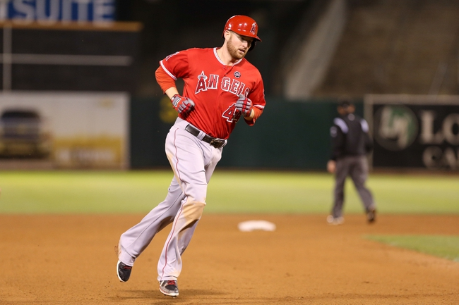 Sep 16, 2013; Oakland, CA, USA; Los Angeles Angels first baseman Mark Trumbo (44) rounds the bases on a two run home run against the Oakland Athletics during the eighth inning at O.co Coliseum. Mandatory Credit: Kelley L Cox-USA TODAY Sports