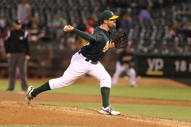 Sep 16, 2013; Oakland, CA, USA; Oakland Athletics relief pitcher Pat Neshek (47) pitches the ball against the Los Angeles Angels during the ninth inning at O.co Coliseum. The Los Angeles Angels defeated the Oakland Athletics 12-1. Mandatory Credit: Kelley L Cox-USA TODAY Sports