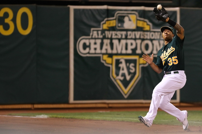 Sep 16, 2013; Oakland, CA, USA; Oakland Athletics center fielder Michael Choice (35) catches the foul ball against the Los Angeles Angels during the ninth inning at O.co Coliseum. The Los Angeles Angels defeated the Oakland Athletics 12-1. Mandatory Credit: Kelley L Cox-USA TODAY Sports