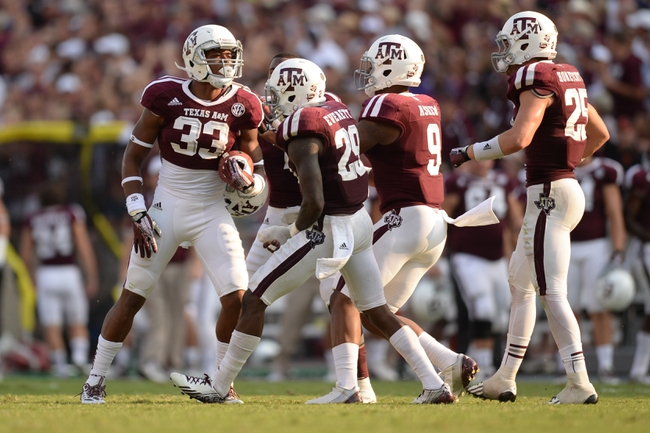 Sep 14, 2013; College Station, TX, USA; Texas A&M Aggies linebacker Shaan Washington (33) celebrates recovering a fumble against the Alabama Crimson Tide  during the second half at Kyle Field. Mandatory Credit: Thomas Campbell-USA TODAY Sports