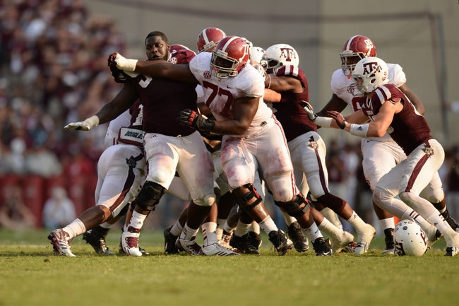 Sep 14, 2013; College Station, TX, USA; Alabama Crimson Tide offensive linesman Arie Kouandjio (77) blocks Texas A&M Aggies defensive lineman Kirby Ennis (90) during the second half at Kyle Field. Mandatory Credit: Thomas Campbell-USA TODAY Sports