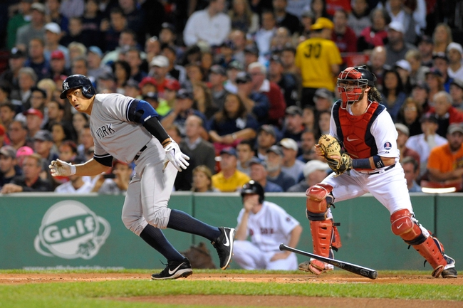Sep 15, 2013; Boston, MA, USA; New York Yankees DH Alex Rodriguez (13) bats during the first inning against the Boston Red Sox at Fenway Park. Mandatory Credit: Bob DeChiara-USA TODAY Sports