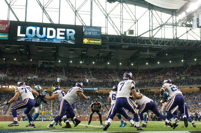 Sep 8, 2013; Detroit, MI, USA;  Minnesota Vikings quarterback Christian Ponder (7) hands off to running back Adrian Peterson (28) during the fourth quarter against the Detroit Lions at Ford Field. Detroit won 34-24. Mandatory Credit: Tim Fuller-USA TODAY Sports