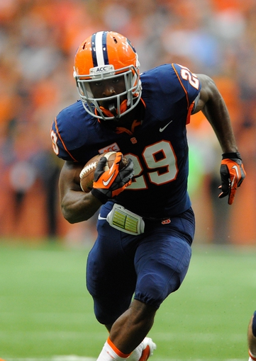 Sep 14, 2013; Syracuse, NY, USA; Syracuse Orange running back Devante McFarlane (29) runs with the ball during the second quarter against the Wagner Seahawks at the Carrier Dome.  Syracuse defeated Wagner 54-0.  Mandatory Credit: Rich Barnes-USA TODAY Sports