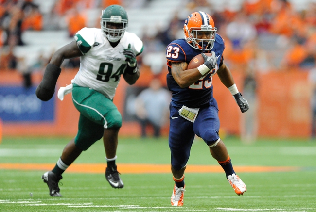 Sep 14, 2013; Syracuse, NY, USA; Syracuse Orange running back Prince-Tyson Gulley (23) runs with the ball in front of Wagner Seahawks defensive lineman Davon Johnson (94) during the second quarter at the Carrier Dome.  Mandatory Credit: Rich Barnes-USA TODAY Sports