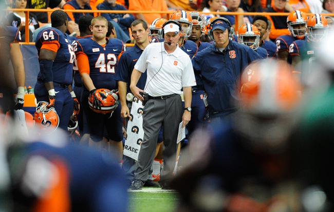 Sep 14, 2013; Syracuse, NY, USA; Syracuse Orange head coach Scott Shafer (center) looks on during the third quarter against the Wagner Seahawks at the Carrier Dome.  Syracuse defeated Wagner 54-0.  Mandatory Credit: Rich Barnes-USA TODAY Sports