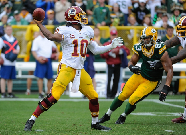Sep 15, 2013; Green Bay, WI, USA;   Washington Redskins quarterback Robert Griffin III (10) during the game against the Green Bay Packers at Lambeau Field. Mandatory Credit: Benny Sieu-USA TODAY Sports