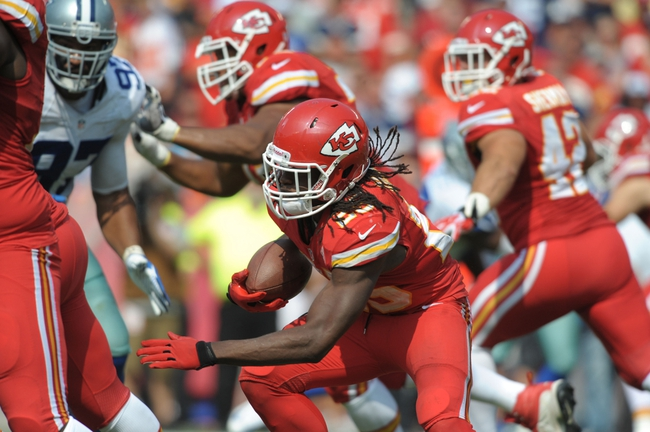 Sep 15, 2013; Kansas City, MO, USA; Kansas City Chiefs running back Jamaal Charles (25) runs the ball during the second half of the game against the Dallas Cowboys at Arrowhead Stadium. The Chiefs won 17-16. Mandatory Credit: Denny Medley-USA TODAY Sports