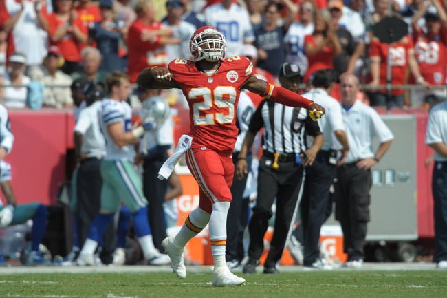 Sep 15, 2013; Kansas City, MO, USA; Kansas City Chiefs strong safety Eric Berry (29) celebrates after a play during the second half of the game against the Dallas Cowboys at Arrowhead Stadium. The Chiefs won 17-16. Mandatory Credit: Denny Medley-USA TODAY Sports