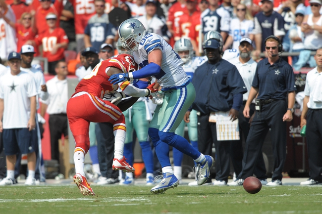 Sep 15, 2013; Kansas City, MO, USA; Kansas City Chiefs defensive back Husain Abdullah (39) breaks up a pass intended for Dallas Cowboys tight end Jason Witten (82) during the second half at Arrowhead Stadium. The Chiefs won 17-16. Mandatory Credit: Denny Medley-USA TODAY Sports