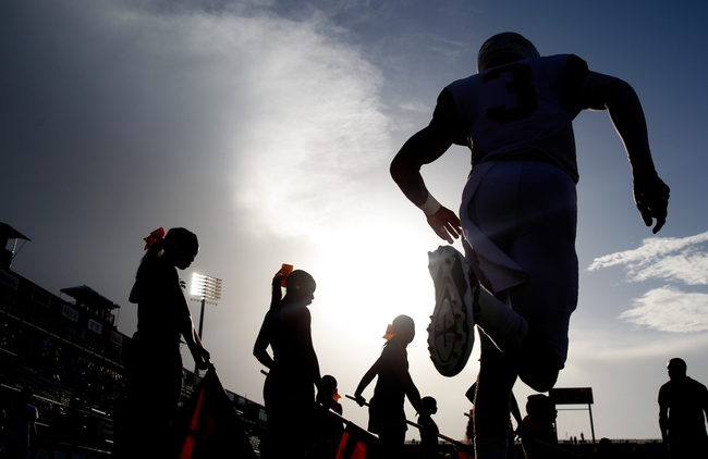 Sep 14, 2013; Miami, FL, USA;  A Bethune Cookman Wildcats player  runs onto the field before a game against the Florida International Panthers at FIU Stadium. Mandatory Credit: Robert Mayer-USA TODAY Sports