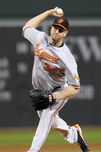 Sep 17, 2013; Boston, MA, USA; Baltimore Orioles starting pitcher Scott Feldman (34) pitches during the first inning against the Boston Red Sox at Fenway Park. Mandatory Credit: Bob DeChiara-USA TODAY Sports