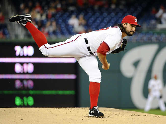 Sep 17, 2013; Washington, DC, USA; Washington Nationals pitcher Tanner Roark (59) throws during the first inning against the Atlanta Braves at Nationals Park. Mandatory Credit: Brad Mills-USA TODAY Sports
