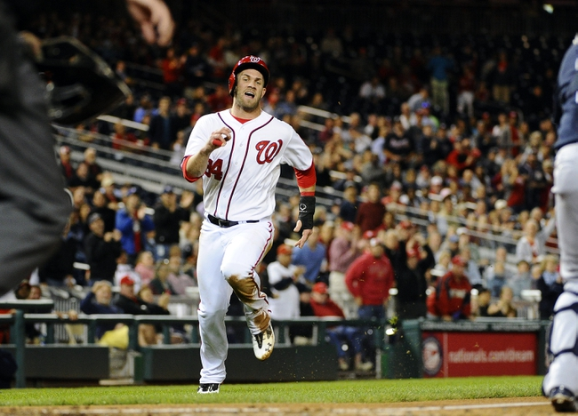 Sep 17, 2013; Washington, DC, USA; Washington Nationals left fielder Bryce Harper (34) scores the first run of the game against the Atlanta Braves during the first inning against the Atlanta Braves at Nationals Park. Mandatory Credit: Brad Mills-USA TODAY Sports