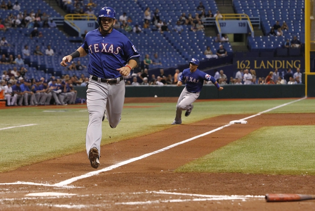 Sep 17, 2013; St. Petersburg, FL, USA; Texas Rangers first baseman Mitch Moreland (18) and center fielder Leonys Martin (2) run home to score off second baseman Ian Kinsler (5) (not pictured) single during the third inning against the Tampa Bay Rays at Tropicana Field. Mandatory Credit: Kim Klement-USA TODAY Sports