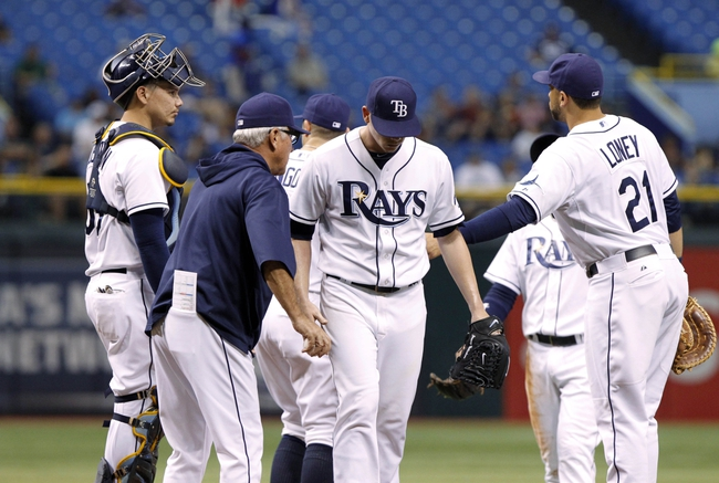 Sep 17, 2013; St. Petersburg, FL, USA; Tampa Bay Rays manager Joe Maddon (70) comes out to take starting pitcher Jeremy Hellickson (58) out of the game during the third inning against the Texas Rangers at Tropicana Field. Mandatory Credit: Kim Klement-USA TODAY Sports