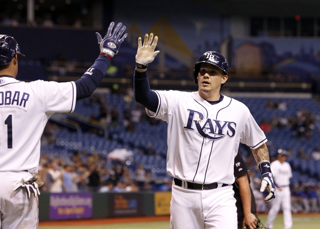 Sep 17, 2013; St. Petersburg, FL, USA; Tampa Bay Rays catcher Jose Lobaton (59) is congratulated by shortstop Yunel Escobar (11) after he hit a solo home run during the third inning against the Texas Rangers at Tropicana Field. Mandatory Credit: Kim Klement-USA TODAY Sports